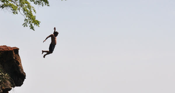 Man Falling Of Cliff
